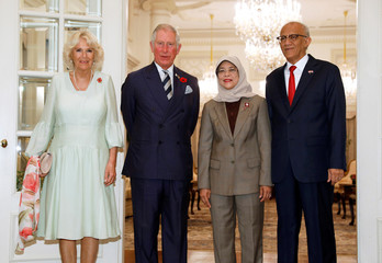 Britain's Prince Charles and Camilla, Duchess of Cornwall, pose for photo with Singapore's President Halimah Yacob and husband Mohammed Abdullah Alhabshee during welcome ceremony at Istana in Singapore