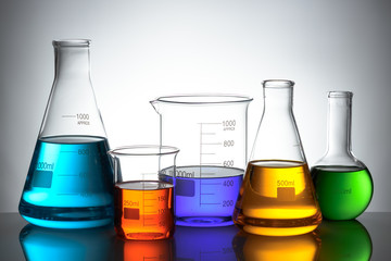 Laboratory glassware set with color liquid and reflection