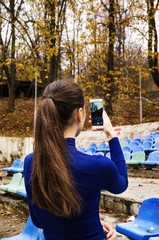 Girl taking photo of nature on smart phone
