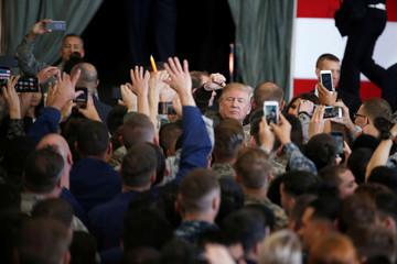 U.S. President Donald Trump greets members of U.S. military services at U.S. Air Force Yokota Air Base in Fussa