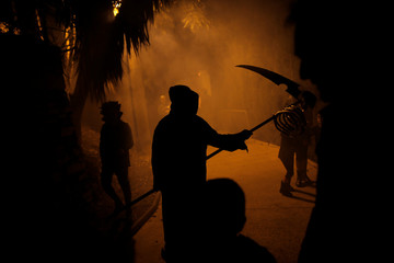 """People dressed up in Halloween costumes take part in """"Noche del Terror"""" (Horror night) during Halloween celebrations in the neighborhood of Churriana, near Malaga"""