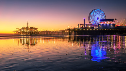 Santa Monica beach and pier in California USA at sunset