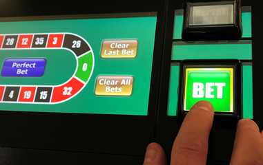 A man gambles on a fixed odds betting terminal inside a Bookmakers in Manchester, Britain.