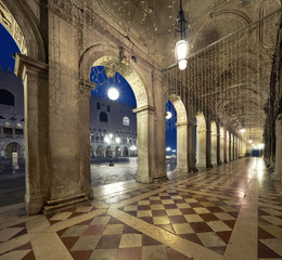 Ancient arches of Doges Palace on St. Marc Square in Venice at night