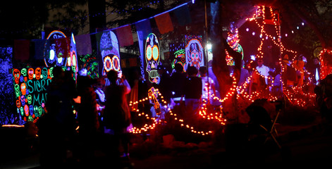 People walk by a house which is decorated for Halloween in Sierra Madre