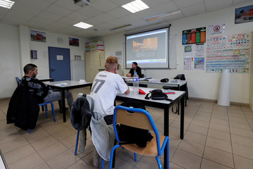 An instructor gives driving theory lesson in a classroom at ''AFTRAL'', a transport and logistics training centre, in Savigny-le-Temple