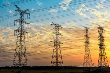 High voltage power tower landscape at sunset