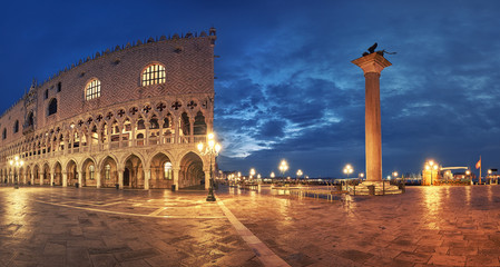 Panoramia of Doge's Palace and St. Marco's square at night in Venice