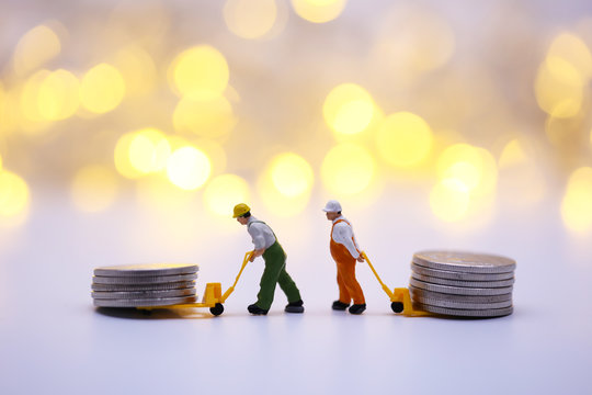 Miniature People: Worker dragging coin