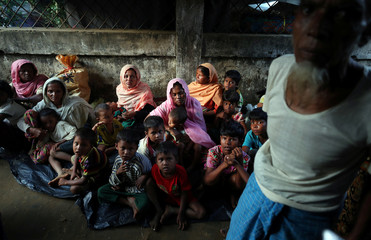 Rohingya refugee take shelter at a school in Kutupalong refugee camp near Cox's Bazar