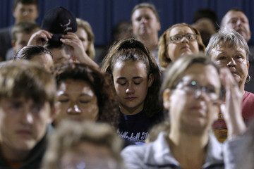 A woman prays during a vigil in the memory of those killed in the shooting at the First Baptist Church of Sutherland Springs in La Vernia