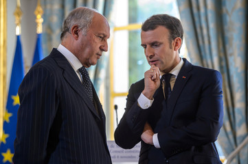 French President Emmanuel Macron talks with Constitutional Council president Laurent Fabius after the oath-taking ceremony of newly-named member of the Constitutional Council Dominique Lottin at the Elysee Palace in Paris