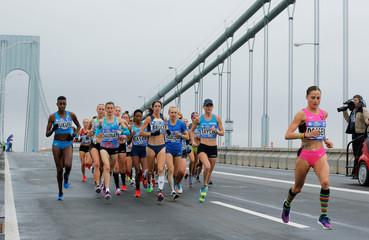 The elite women runners make their way across the Verrazano-Narrows Bridge during the start of the New York City Marathon in New York