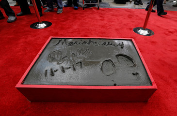 The handprints, footprints and signature in cement of singer Mariah Carey are pictured in the forecourt of the TCL Chinese theatre in Los Angeles