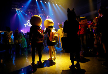 Participants in costumes dance at a club during a Halloween event in Kawasaki