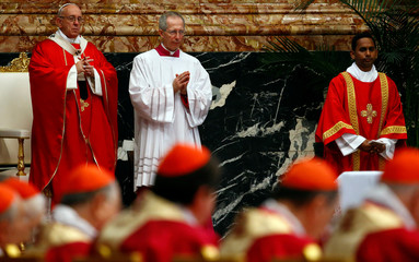 Pope Francis prays as he leads a Mass for cardinals and bishops who have passed away over the past year, at the St. Peter's basilica in Vatican