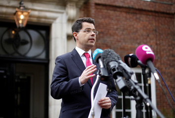 Britain's Northern Ireland Secretary of State James Brokenshire speaks to media outside Stormont House in Belfast