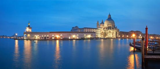 Illuminated Punta della Dogana and church Santa Maria della Salute in Venice