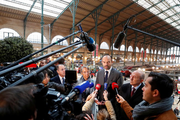 French Prime Minister Edouard Philippe, Interior Minister Gerard Collomb and Transports Minister Elisabeth Borne talk to journalist after a meeting with police forces during a visit at the Gare du Nord train station in Paris