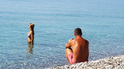 Man taking photo a woman on beautiful paradise  beach.