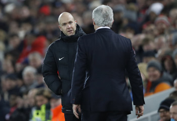 Stoke City manager Mark Hughes talks to fourth official Anthony Taylor