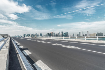 empty asphalt road with city skyline background in china..
