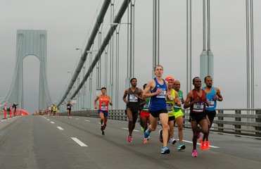 The elite men runners make their way across the Verrazano-Narrows Bridge during the start of the New York City Marathon in New York