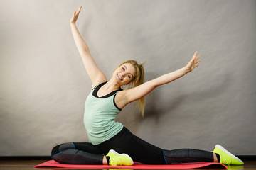 Woman in sportswear stretching legs