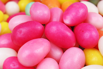 Easter candy. Egg shaped sugar candy for easter season. Egg shaped candy. Pink yellow.