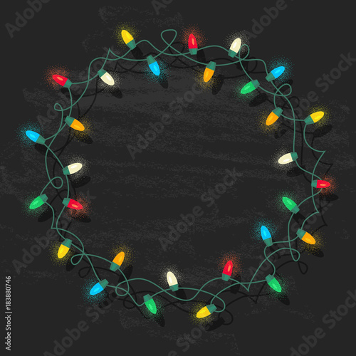 circle frame of glowing colorful christmas lights on chalkboard