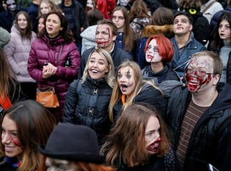 """Participants dressed as zombies take part in a """"Zombie Walk"""" parade in Kiev"""