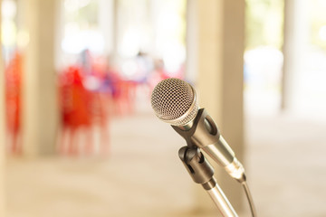 Close up microphone at conference in restaurant .