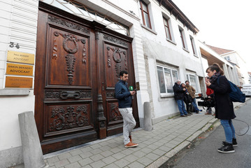 Journalists wait outside the offices of Carles Puigdemont's lawyer in Tielt in Belgium