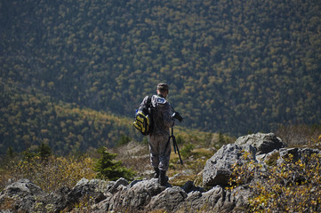 photographer in the mountains autumn mountains nature of the Far East of Russia