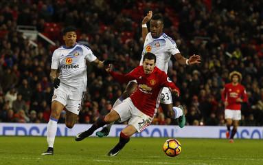 Manchester United's Henrikh Mkhitaryan in action with Sunderland's Patrick van Aanholt (L) and Lamine Kone