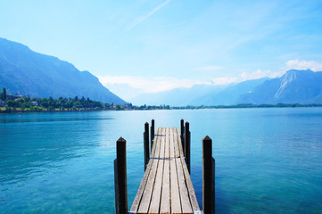 Photo Blinds Lake Old boat dock near Chateau de Chillon, Montreux, Switzerland at leman geneva lake