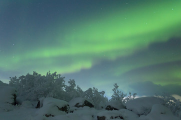 Beautiful polar lights ,aurora over hills and tundra in the winter.