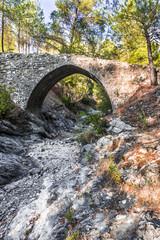 Stone bridge over a dry mountain stream