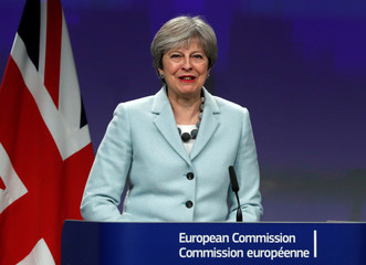 Britain's Prime Minister Theresa May speaks at a news conference at the EC headquarters in Brussels