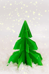 miniature paper pine tree figure, selective focus