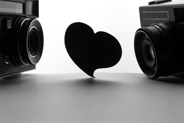 heart and old retro cameras. Space for text or image. Love photography concept.