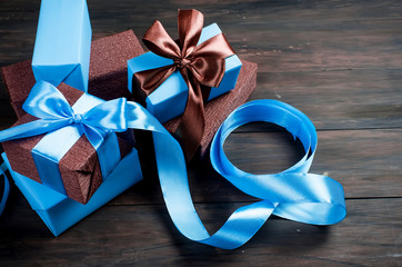 packing and decorating a handmade Christmas gifts in blue and brown