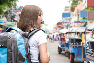 Young Asian woman tourist backpacker traveling alone in Khao San road Thailand Wall mural