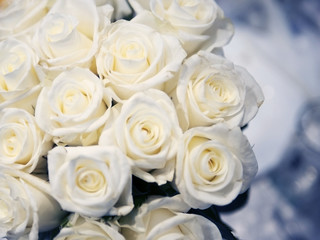 Wedding bouquet of white roses. Closeup, background