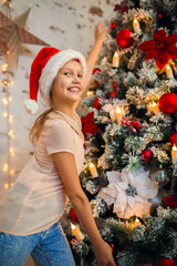 Photo of girl in Santa caps on background of New Year's decorations
