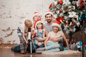 New Year's image of parents, two daughters and son with telescope
