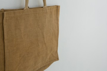 Bag hanging against white wall