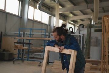 Carpenter making wooden frame