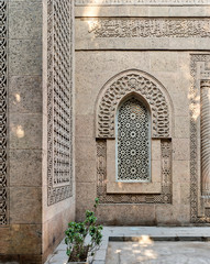 Arched window with grid of ornate marble geometric pattern in the bricks stone wall of the mosque of The Manial Palace of Prince Mohammed Ali Tewfik, Cairo, Egypt
