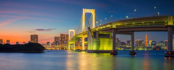 Rainbow Bridge Panorama, Tokyo. Panoramic cityscape image of Tokyo, Japan with Rainbow Bridge during sunset.